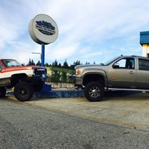 Trucks in front of auto shop