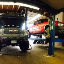 Trucks in shop and on lift